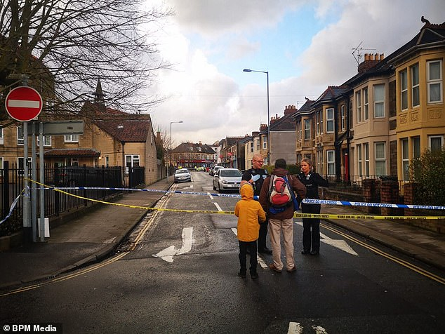 Two men, one aged in his 20s and the other in his 50s, were stabbed in the incident, and were taken to Southmead Hospital (Pictured: Police at the scene on Tuesday)