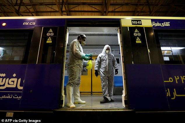 Tehran health workers clean a metro train this morning in an effort to stop the coronavirus outbreak which has spread from Iran across the Middle East