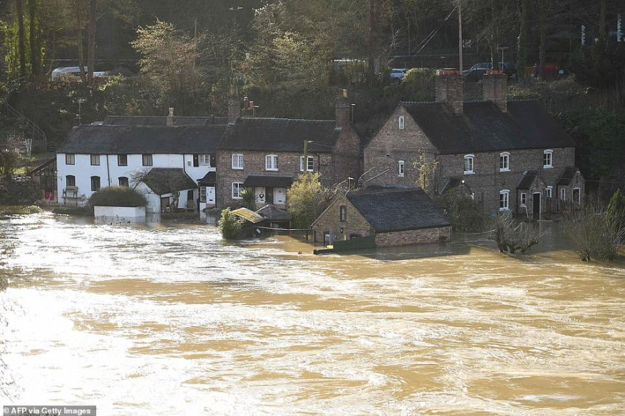 Homes surrounded and submerged in flood water in Ironbridge, Shropshire, this morning