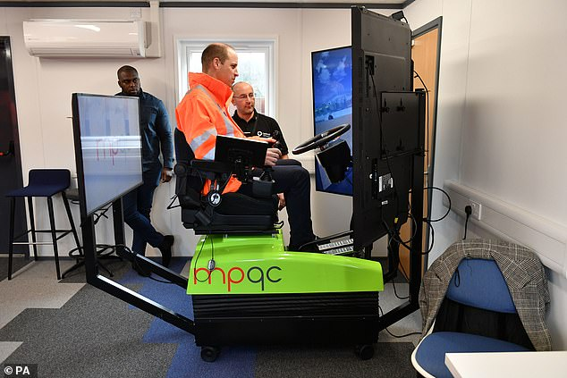 The Duke of Cambridge was keen to get stuck in and was picturedoperating an excavator simulator