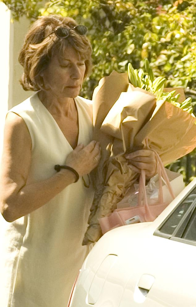 In 2005 Sir Martin paid a then record divorce settlement of £29 million to his wife of 33 years, Lady Sandra (pictured). He went on to marry Cristiana Falcone in 2008
