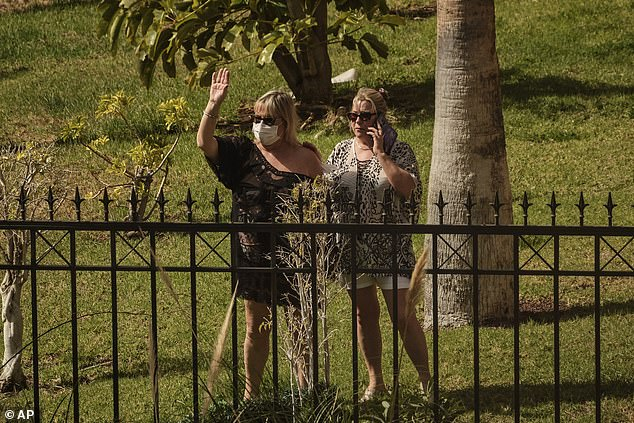 Tourists in quarantine wave from inside the H10 Costa Adeje Palace hotel in Tenerife today