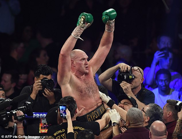 Tyson Fury celebrates after beating Deontay Wilder in Las Vegas on Saturday night