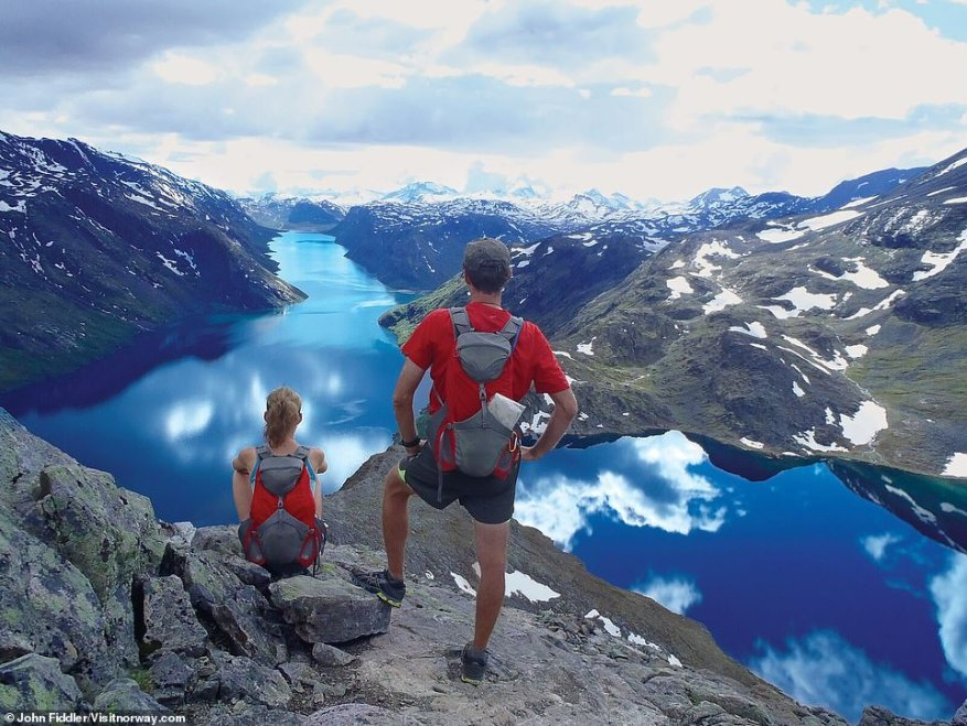 Hikers pause to take in the jaw-dropping view from Besseggen ridge in Jotunheimen National Park