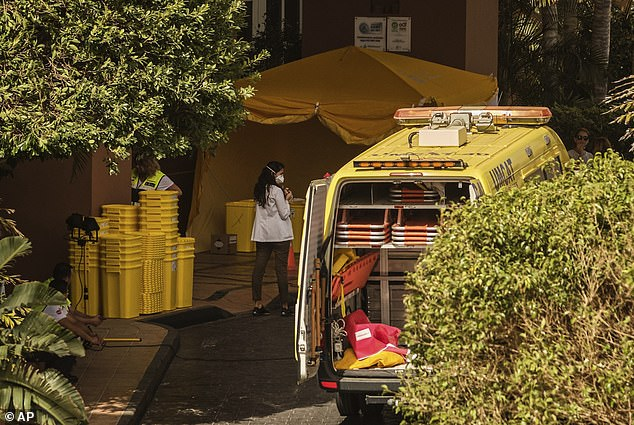 A vehicle is parked outside theH10 Costa Adeje Palace hotel today, with Spanish authorities enforcing a lockdown and also hunting for tourists who previously stayed at the hotel