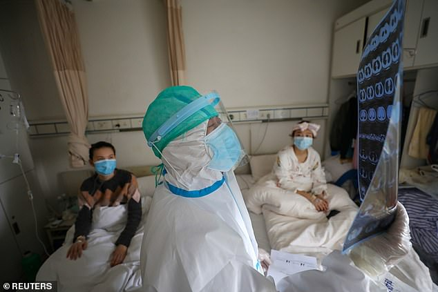 The picture shows a medic working in a hospital in Wuhan, the epicentre of the coronavirus