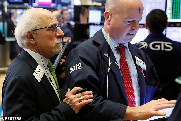U.S. stock indexes opened higher on Wednesday, after four days of steep selloffs amid fear of the coronavirus. Pictured above are traders on the NYSE on Ash Wednesday