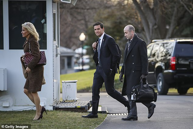 John McEntee (center), walking to Marine One with Kellyanne Conway (left) and Stephen Miller (right) was originally fired in March 2018 due to an alleged gambling problem