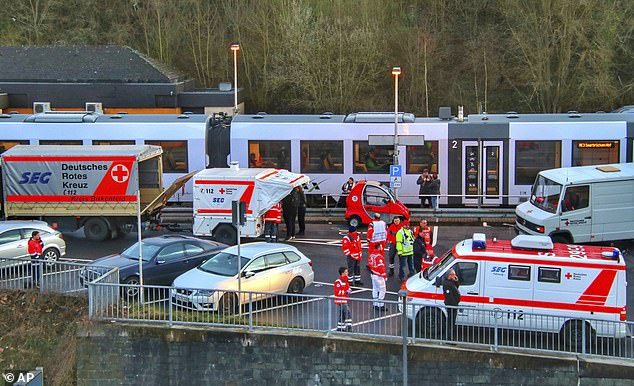 Alarm: A fleet of emergency workers and a halted train atIdar-Oberstein station in Germany yesterday after a passenger showed possible virus symptoms