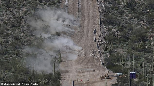 Construction crew perform a controlled detonation at the base of Monument Hill in Organ Pipe Cactus National Monument west of Lukeville, Arizona, on Wednesday