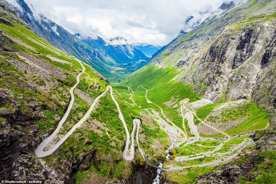 Pictured here is the majestic Trollstigen road, which has 11 hairpins and threads its way through a dramatic valley formed by mighty mountains over 5,000 feet tall. The road opened in 1939