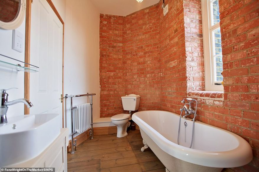 Take a bath in unique red brick surroundings and peer out into the rolling countryside of the Suffolk village of Melton