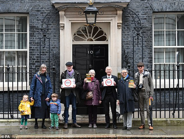Author and historian Tom Holland, second left, took a petition of more than 50,000 signatures to Downing Street on February 19 calling for the plan to be scrapped
