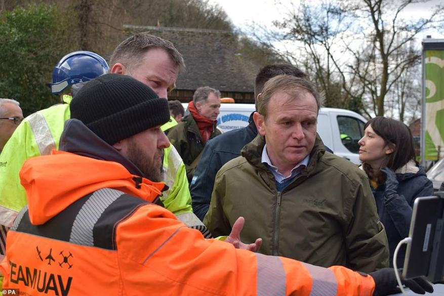 Environment Secretary George Eustice views a screen showing drone camera images of flood defences in Ironbridge today