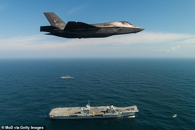 The MoD's predicts its rolling 10-year programme to purchase and support aircraft, ships and weaponry will cost £183.6b between 2019 and 2029 – a budget overrun of £2.9b (pictured is aF-35B fighter jet flies over HMS Queen Elizabeth while in Portsmouth)