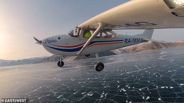 A plane was spectacularly filmed landing on to LakeBaikal - the world's deepest lake - despite dire warnings of thin ice. It was organised by photographer Vadim Makhorov andAndrey Melnikov, along with two other pilots