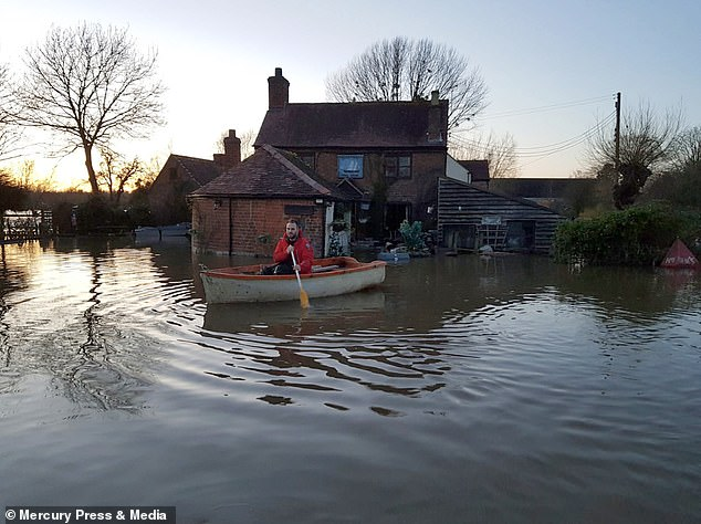 Flooding at the Boat Inn in Ashleworth, Gloucs, where the River Severn has breached defences