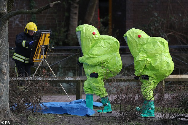 Mr Levy's interview came at the time of the poisoning in Salisbury of Russian Sergei Skripal and his daughter Yulia. Pictured: Crime scene investigators walk in hazmat suits in the town