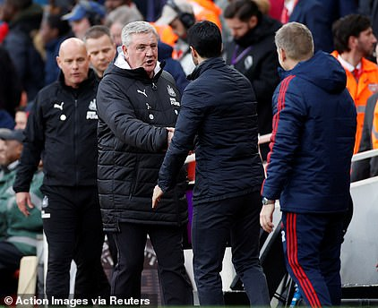 Newcastle United boss Steve Bruce shakes hands withArsenal manager Mikel Arteta - but Bruce has admitted the ritual is banned at the training ground because of coronavirus