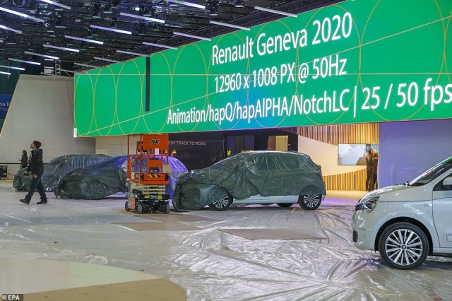 A view of cars inside an exhibition hall as workers stopped preparations for the 90th Geneva International Motor Show, which was scheduled to begin on March 5