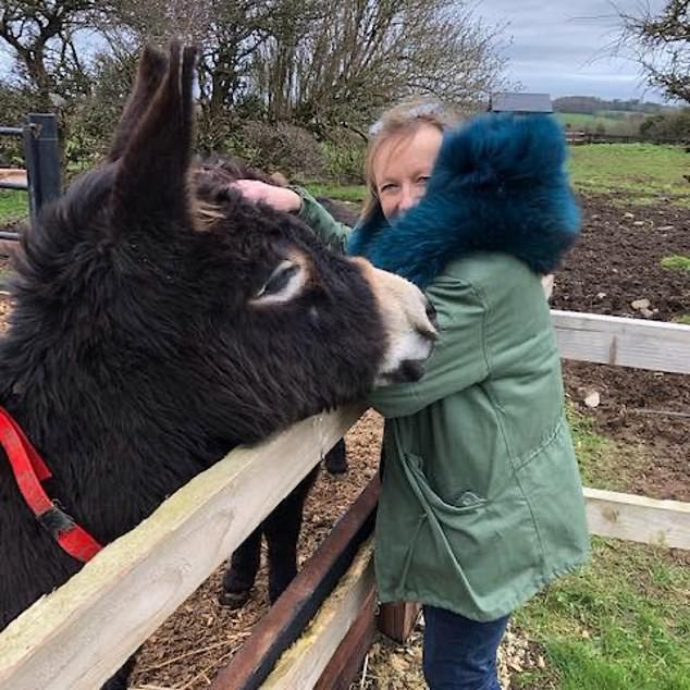 Debbie Zurick was particularly fond of Mr Ryan's two donkeys (seen above with her) which roam around the fields of Ballytrent and posted pictures of her hugging them on her Facebook page