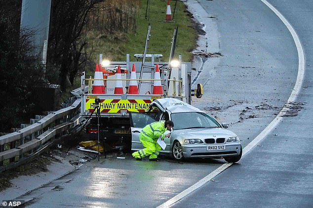A silver BMW hit a stationary maintenance vehicle on the hard shoulder of the clockwise carriageway of the M60 motorway near Junction 23 for Audenshaw, Greater Manchester