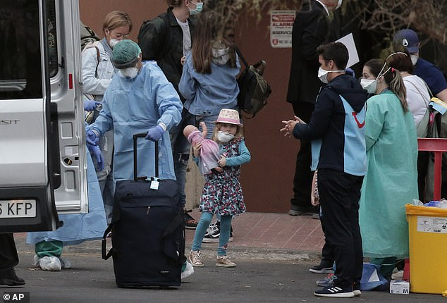 People are seen leaving the Costa Adeje Palace hotel in La Caleta in Tenerife on Friday