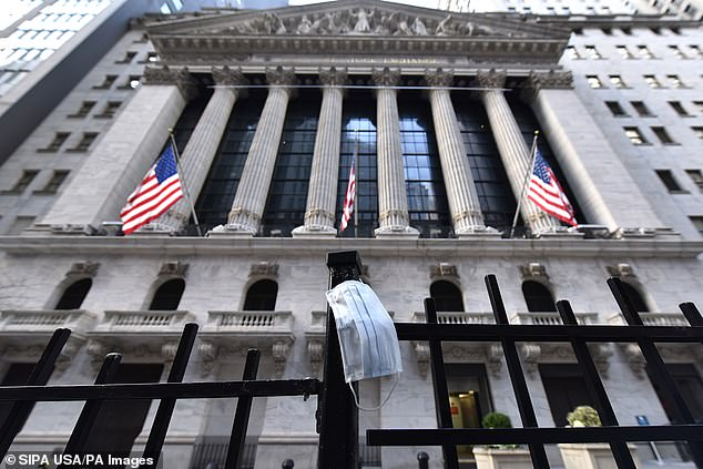 The New York Stock Exchange is preparing for the chance that it may have to shut its trading floor amid a panic the coronavirus could spread into a wider pandemic. The exterior of the exchange is pictured on Manhattan's Wall Street Friday