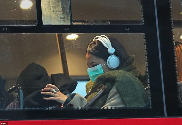 Britain's 20th coronavirus case was last night confirmed - after a British man who was on board the Diamond Princess cruise ship died in Japan yesterday. Pictured: A woman wearing a face mask on a London bus