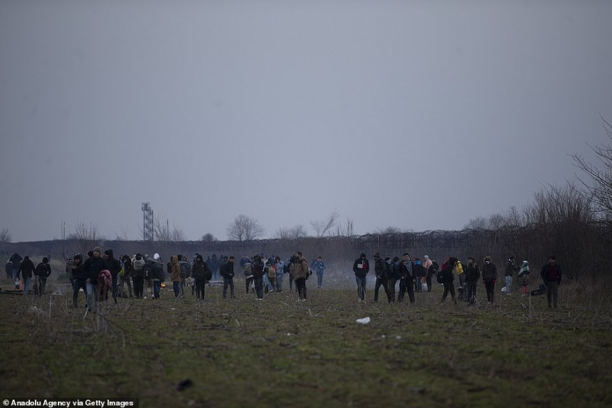Greek border police throw tear gas canisters and stun grenades to send away irregular migrants trying to Greece through Turkey's border in Edirne, Turkey today