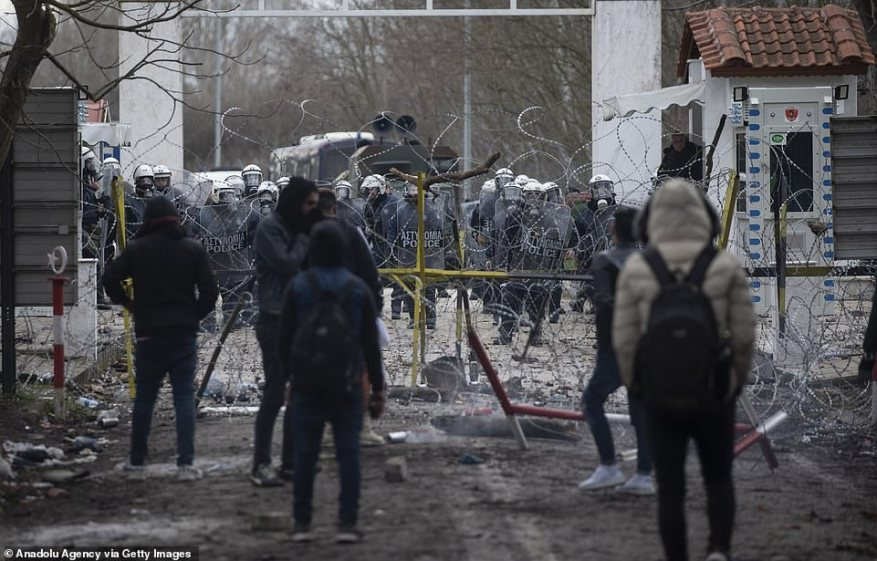 Greek border police throw tear gas canisters and stun grenades to send away irregular migrants trying to enter the Greek side of Turkey's border with Greece in Edirne, Turkey today