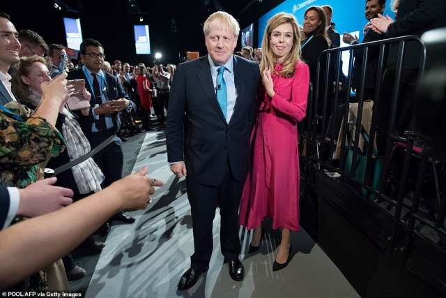 While he was still married, he began dating PR guru and Tory adviser Ms Symonds, and the couple are believed to have been dating for close to two years (pictured in 2019 at the party conference in Manchester)