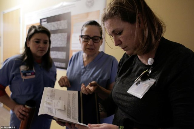Harborview Medical Center's home assessment team, including (L to R) Michelle Steik, Lucy Greenfield, and Krista Reitberg prepare to visit the home of a person potentially exposed to novel coronavirus, at Harborview Medical Center in Seattle