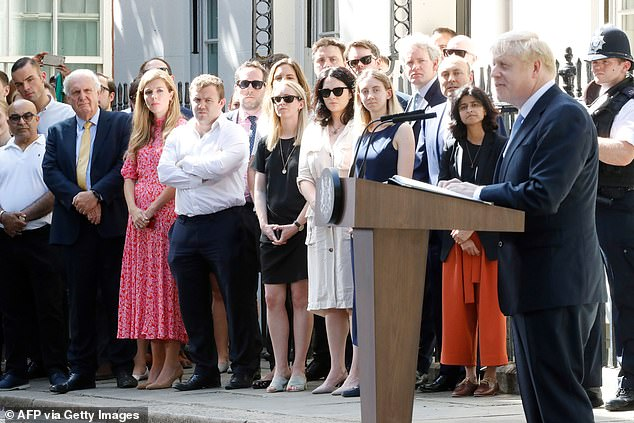 SUPPORTIVE: Carrie joins No 10 staff to watch Boris's first speech as Prime Minister last June. The next day he announced in the Commons environmental policies close to her heart
