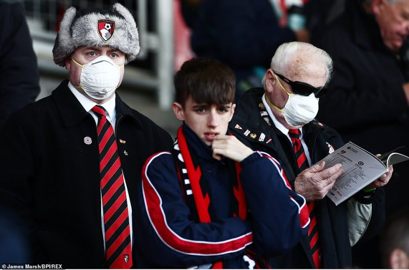 Bournemouth fans wore protective facemasks branded with the club's crest in the crowd during the game againstChelsea yesterday