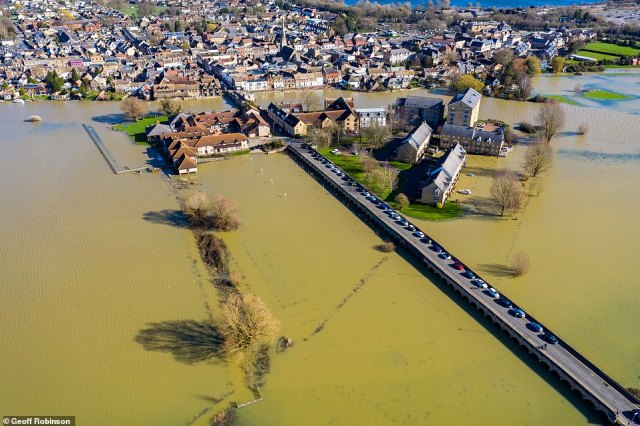 The town of St Ives in Cambridgeshire surrounded by flood water.Dozens of flood warnings are still in place across England, Wales and Scotland, meaning immediate action is required