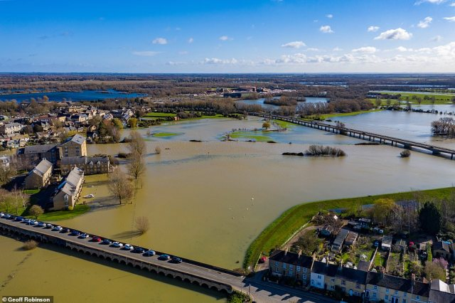 Storm Jorge was the latest in a series which have struck the UK, bringing heavy downpours, 70 mph gales and snow.Pictured is St Ives in Cambridgeshire