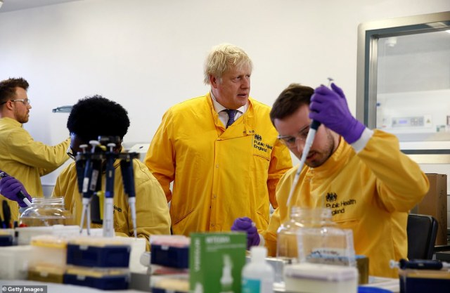 The PM today admitted the coronavirus outbreak was going to be a challenge. He hailed frontline NHS staff as the UK's 'greatest asset' in the face of the coronavirus outbreak.  Pictured: Boris visits a laboratory in Public Health England's National Infection Service on Sunday