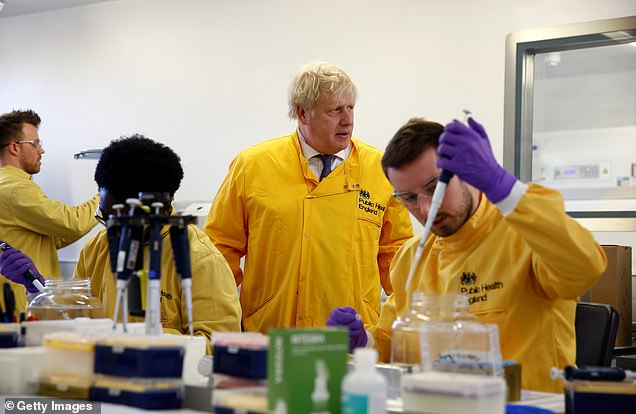 Prime Minister Boris Johnson has hailed NHS staff as the UK's 'greatest asset' in the face of the coronavirus outbreak. Pictured: Mr Johnson visiting a Public Health England laboratory on Sunday