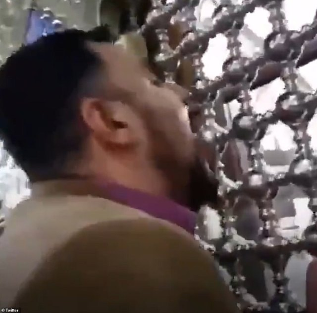 Clips on social media have shown people licking the doors and the burial mound inside the Masumeh shrine