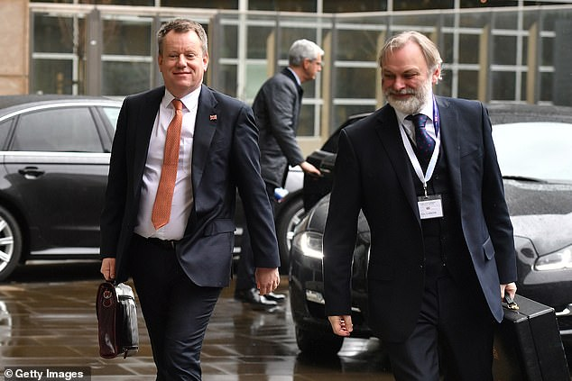 Mr Frost (left) was accompanied by UK ambassador Sir Tim Barrow as he arrived at the European Parliament today