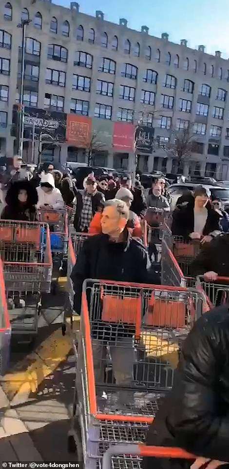 Shoppers waiting outside a Costco in Brooklyn