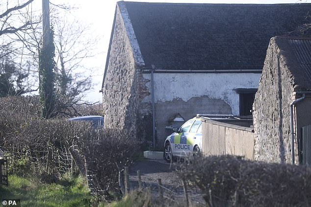 Police in Bankhall Road, Larne at the scene of a major incident at a farmhouse in County Antrim on Monday
