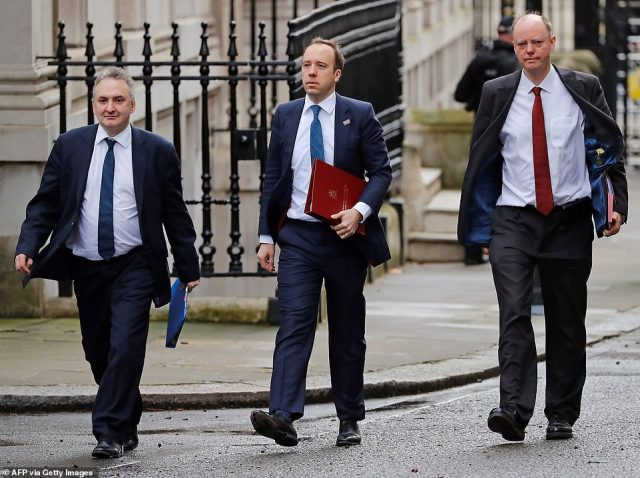 Mr Hancock (centre) arrived yesterday in Downing Street accompanied by Department of Health permanent secretary Chris Wormald (left) and Professor Chris Whitty (right)