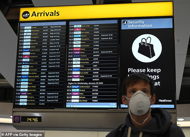 BA grounded 24 flights between Heathrow and New York's JFK airport. Pictured: A man wears a mask in London's Heathrow Airport