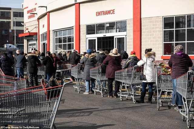 Panic buying hit New York and other parts of the country over the weekend with anxious shoppers clearing supermarket shelves as they stock up on food and medical supplies. Pictured is a Costco in Brooklyn on Monday