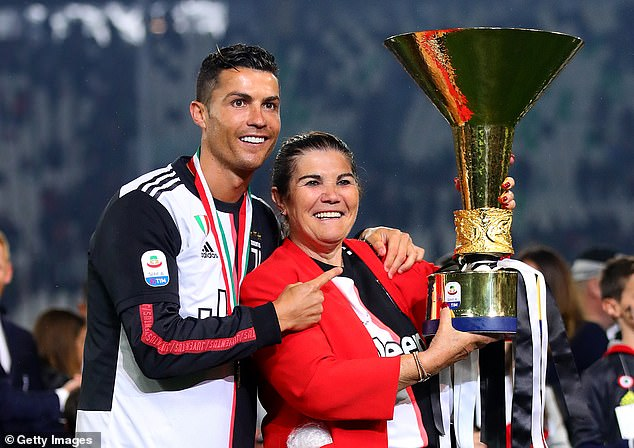 Cristiano Ronaldo's mother Dolores Aveiro (pictured with the football star last year) has reportedly been rushed to hospital after suffering a stroke