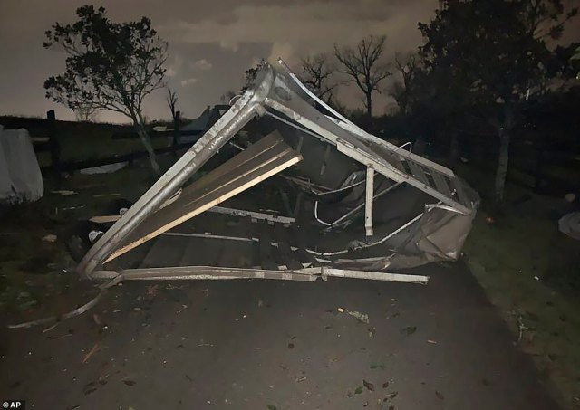 A damaged horse trailer lying toppled over at the Hidden Acres Farm after a storm touched down in the area around Nashville