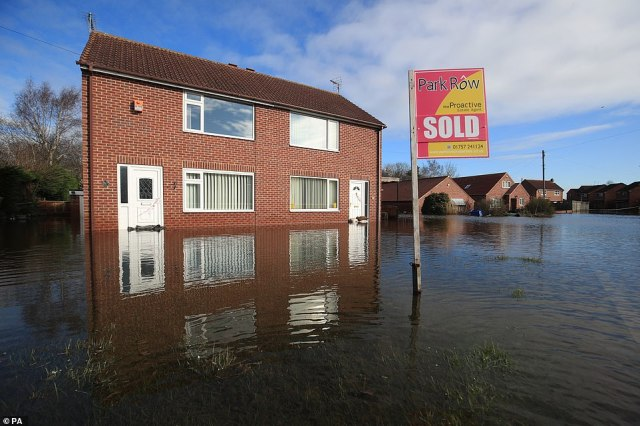 Floodwater surrounds homes in Snaith, East Yorshire, as dozens of flood warnings are still in place for England today