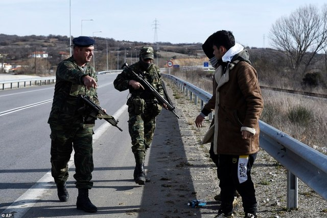 The Greek Army detains migrants in the village of Mandra, along the banks of the Evros river, after they crossed from Turkey